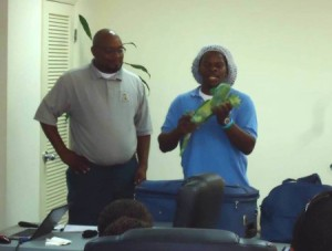 Scott Johnson of the Bahamas National Trust (right) speaks to Bahamian and Turks and Caicos Islands enforcers on wildlife smuggling during a workshop. (Photo: BirdsCaribbean, courtesy of Scott Johnson)