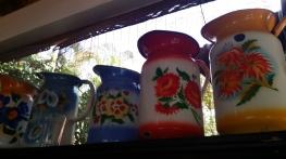 Painted enamel jugs - everyday items, part of our heritage.