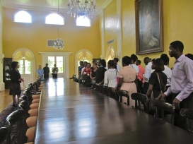 We lined up along this beautiful long dining table, which reflected the light from the upper windows. (My photo)
