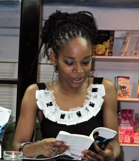 Poet Ann-Margaret Lim reads from her first book of poetry, Festival of the Wild Orchid, at the launch at Bookophilia, Kingston in 2012. Poets like her are Jamaica's living heritage.