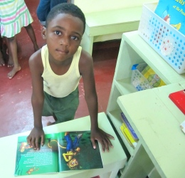 This little boy at Trench Town Reading Centre was taking a peek at an interesting book.