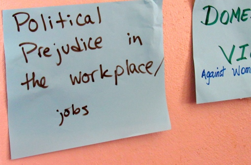 Last year the 51% Coalition conducted a series of workshops with rural women, and many stickers came into play. Here was one of the issues some women identified. (My photo)