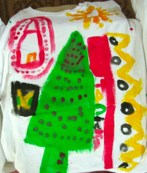 Textiles are textures. Of course! This is a T shirt made by a child at Trench Town Reading Centre for Christmas.