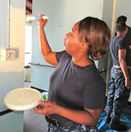 "A crew member of the US Navy Ship ""Comfort"" refurbishing the Ozanam Old People's Home in Kingston."