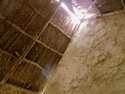 Inside a replica of a slave hut in Seville, St. Ann.