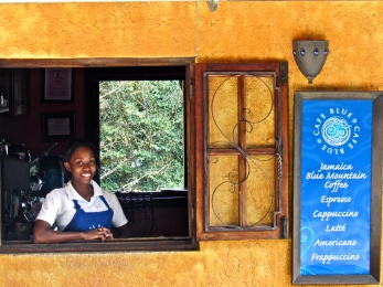 At Cafe Blue, an idyllic spot up in the hills of Irish Town, this young waitress posed in the window for me.