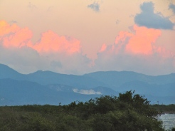 Pink evening clouds glowing above the mountains of St. Andrew.
