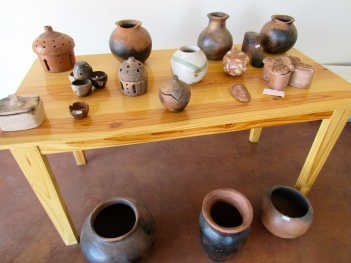 Craftsmen in Rose Town in Kingston make some lovely pots...on display here.