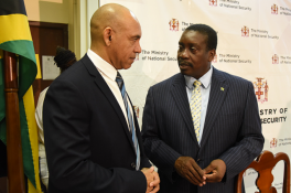 The new Chair of the Firearm Licensing Authority (FLA) Major General Antony Anderson (left) talks to National Security Minister Robert Montague.