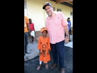 Mark Golding with a young PNP supporter in St. Andrew South.