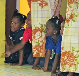 Several children were having fun peeking through curtains at a cultural performance, at Content Gap, St. Andrew. They thought no one could see them, but...my camera was peeking...