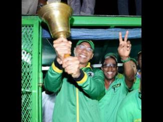 Prime Minister Andrew Holness ringing the Jamaica Labour Party's bell of victory with winning candidate Dr Norman Dunn for St Mary South East. (Photo: Ricardo Makyn/Gleaner)