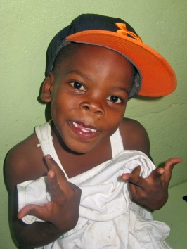 A little boy at Trench Town Reading Centre strikes a pose at a Christmas party three years ago. (My photo)