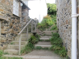 """Many villages in Cornwall, UK are """"uphill and downhill."""" Here are steps ascending to houses in the tiny village of Port Quin."""