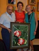 "A Lovely Evening Featuring Beautiful Artwork: Tarun Handa (left), Managing Partner at KPMG, with wife Catherine (centre) and Canadian artist Brenda Mitchell (right) smile together, holding the painting ""Cannonball Run"" at Friends of Food For The Poor Jamaica' 2018 Calendar Launch and Auction at the Terra Nova Hotel on Thursday, November 30, 2017. Food For The Poor held the 2018 Calendar Launch in partnership with Young At Art, an art education programme founded and run by Fiona Godfrey. All proceeds from the event will benefit the Savanna-la-Mar Hospital."