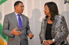 Prime Minister Andrew Holness talks to the Electoral Commission of Jamaica Chair Dorothy Pine-McLarty at the political party registration event earlier this year.