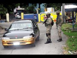 Members of the JDF on patrol in St. James during the State of Public Emergency.