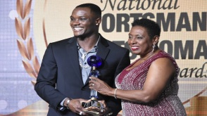 Sprint hurdler Omar McLeod (left) receives the 2017 RJRGleaner National Sportsman of the Year award from Sport Minister Olivia Grange at the gala ceremony, held at the Jamaica Pegasus hotel in New Kingston on Friday, January 19. (PHOTO: Marlon Reid).