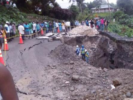 A road collapse in West Hill, Portland after rains and flooding.