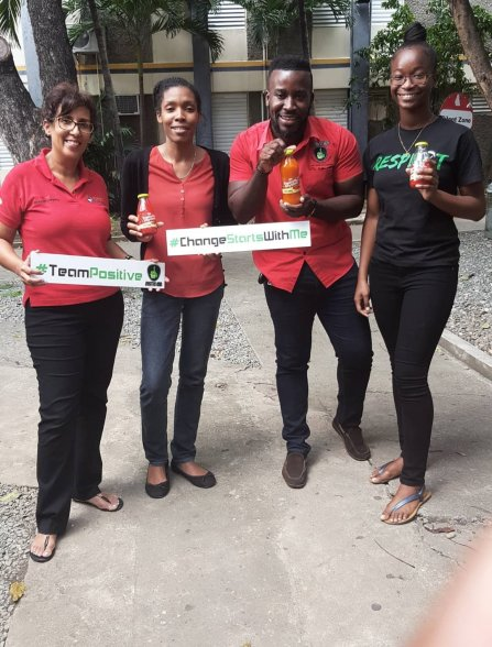 Neville Charlton and fellow volunteers with Caroline Mahfood, head of the GraceKennedy Foundation, after the Advocacy 101 workshop at Utech.