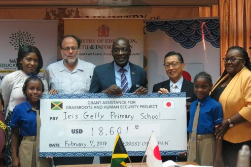 Member of Parliament Mark Golding with Education Minister Ruel Reid and a nice cheque for Iris Gelly Primary School from the Japanese Embassy.