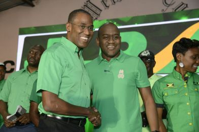 New candidate Nigel Clarke (left) shakes hands with Councillor Duane Smith at the JLP's announcement of Clarke's candidacy in Smith's father's former constituency.