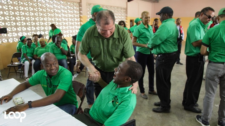 Finance Minister Audley Shaw greets candidate Nigel Clarke on Nomination Day.