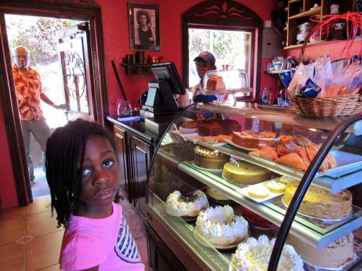 """Here's another little girl, by the name of Stephanie... That look says """"So many sweet things - which shall I choose?"""" At Cafe Blue in Irish Town. (My photo)"""