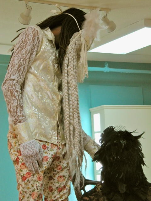 Art is often about the art of concealment. These feathery, fantastic masks completely hide the faces of two Jamaicans in an installation at the National Gallery of Jamaica by Ebony Patterson.