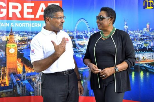 Minister of Culture, Gender, Entertainment and Sport, Hon. Olivia Grange (right), listens to British High Commissioner to Jamaica and The Bahamas, His Excellency Asif Ahmad, at the launch of the UK/Jamaica Fair and Songs of the UK in Jamaica competition at the British High Commission. (Photo: JIS)