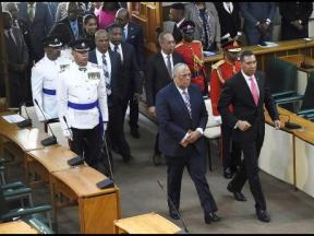 Opposition Leader Dr. Peter Phillips (left) and Prime Minister Andrew Holness walk into Parliament on the Official Opening Day, on which the budget was tabled. (Photo: Gleaner)