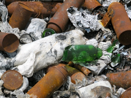 Burned aerosol cans at an unofficial dump near Norman Manley International Airport. (My photo)