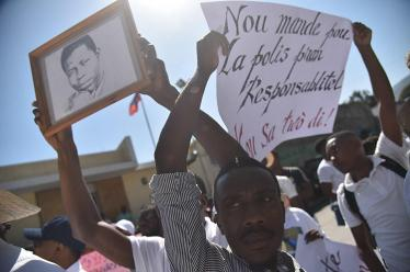 Haitian reporters and others march through the streets of Port-au-Prince, on March 28, 2018, asking for information about the freelance photojournalist Vladimir Legagneur who is missing since March 14,2018 while he was going to make a report. The 30-year-old was last seen March 14 when he left home on a reporting assignment in Grand-Ravine, one of Port-au-Prince's poorest neighborhoods and in recent years the scene of violent gang wars. / AFP PHOTO
