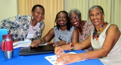Smiles from four beautiful Jamaican feminists: (l-r) Mariama Williams, Joan Grant Cummings, Linnette Vassell and Judith Wedderburn.