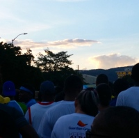 Walkers start walking as the dawn creeps up over Long Mountain ahead of us.
