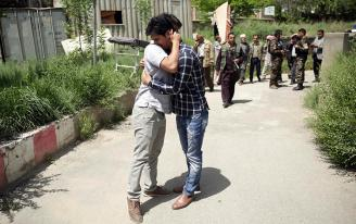 Journalists mourn for their colleagues, who have been killed in the second bombing, in Kabul, Afghanistan, Monday, April 30, 2018. A coordinated double suicide bombing by the Islamic State group hit central Kabul on Monday morning, killing at least 25 people, including eight journalists, officials said. (AP Photo/Massoud Hossaini)