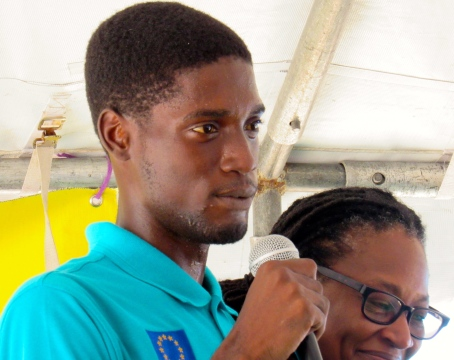 A young trainee is overcome with shyness, when a microphone is put in his hand, at the official launch of the Voices for Jamaica Today Foundation.