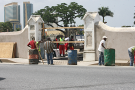 The crew of a United States Naval Ship took part in a ceremony to rededicate the Perry Gate on Lapeyrouse Cemetery in Port-of-Spain, Trinidad, here being refurbished. Trinidadian and U.S. officials jointly hosted a memorial in honor of US naval hero Oliver Hazard Perry (1785 - 1819) for whom the gateway was named. (Photo: Dion Roach/Trinidad Guardian)