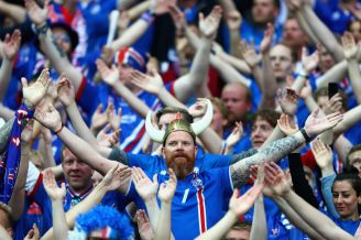 The Iceland fans are in a class of their own. They have a special clap called a thunderclap (I think) and there is an emoji for #VikingClap