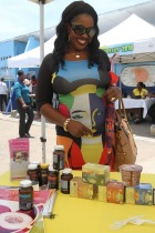 A highly fashionable audience member looks at various products made from natural Jamaican ingredients. (Photo: NHMJ)