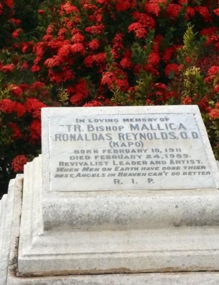 "Mallica ""Kapo"" Reynolds' grave in a burst of colour."