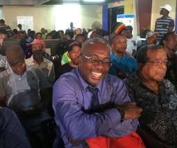 Mixed emotions: The faces of some of those attending the tumultuous (but apparently inconclusive) Town Hall Meeting on the National Heroes Park development. (Photo: Twitter)