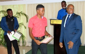 Treasurer of the Jamaica Amateur Athletics Association Ludlow Watts helped present awards and certificates (which got a little hectic at times!) My photo.