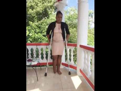 Surgix Jamaica Limited has come to the rescue of Safoy Fearon, who lost her foot after a truck crashed into her in Steer Town, St. Ann. (Photo: Gleaner)