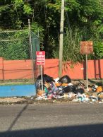 """""""Violators will be prosecuted"""": Broadcast journalist Cliff Hughes took this photo on the main road in Stony Hill, St. Andrew. (Twitter)"""