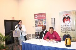 """The body language in this photograph tells you a lot... """"We are ready to collaborate with the government to tackle HIV & AIDS,"""" UNAIDS country director Manuela Manoeva tells Minister Chris Tufton at the Joint Civil Society Forum meeting on HIV. Jamaica AIDS Support for Life (JASL) Policy & Advocacy Officer Patrick Lalor is on the left of the Minister. (Photo: JASL/Twitter)"""