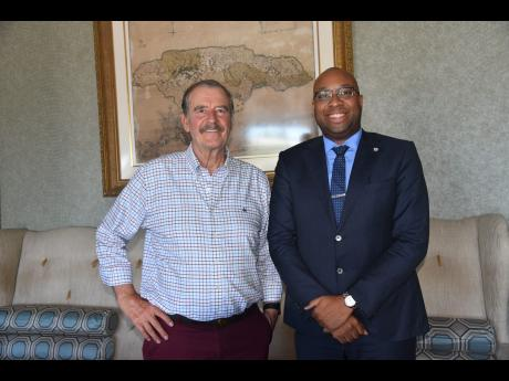 Former president of Mexico Vicente Fox Quesada (left) with local ganja advocate Delano Seivwright at the CanEx Business Conference and Expo being held at the Montego Bay Convention Centre in Montego Bay, last week. (Photo: Gleaner)