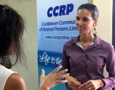 Dr. Ishtar Govia of Alzheimer's Jamaica talks to a CCRP member at a recent presentation on dementia in Jamaica. September was Alzheimer's Month. (My photo)
