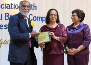 Living Legacy awardee Dr. Owen James of Mandeville receives his award and citation from Minister of Labour and Social Security (centre) and CCRP Executive Chair Jean Lowrie-Chin. (My photo)