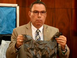 "Serious ting: Minister Daryl Vaz holds up a plastic ""scandal bag"" - a major blight on our landscape and environment - at the recent press briefing on the plastics ban."